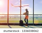 young alone woman waiting in... | Shutterstock . vector #1336038062