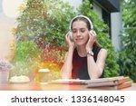 good looking woman sitting... | Shutterstock . vector #1336148045