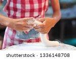 cook is preparing bread dough... | Shutterstock . vector #1336148708