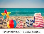 beach flip flops on the sand.... | Shutterstock . vector #1336168058
