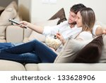 young couple watching tv on a... | Shutterstock . vector #133628906