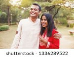 happy indian man and woman... | Shutterstock . vector #1336289522