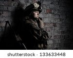 Dramatic portrait of a beautiful girl in uniform. Women in the military. U.S. Marines. Thoughts about the war. Young soldier. The spirit of liberty.