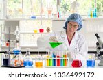 scientist or chemist pouring... | Shutterstock . vector #1336492172