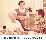 aged parents arguing with their ... | Shutterstock . vector #1336492355