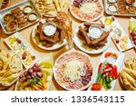 a lot of delicious food on the... | Shutterstock . vector #1336543115