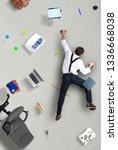 businessman climbs the wall as... | Shutterstock . vector #1336668038