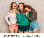 three young beautiful smiling... | Shutterstock . vector #1336746488