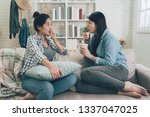 shocked young woman telling her ... | Shutterstock . vector #1337047025