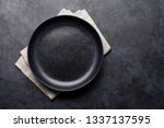 empty plate over kitchen table. ... | Shutterstock . vector #1337137595