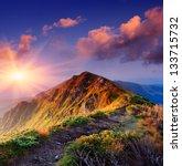 Stock photo beautiful summer sunrise in mountains path along the ridge leading to summit 133715732