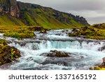 powerful cascading waterfalls... | Shutterstock . vector #1337165192