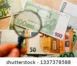 checking a 50 euro banknote... | Shutterstock . vector #1337378588