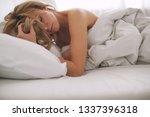 woman in bed  | Shutterstock . vector #1337396318