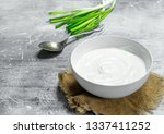 sour cream with green onions in ...