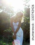 beautiful girl in white dress...   Shutterstock . vector #133742426
