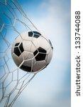 soccer ball in net on blue sky | Shutterstock . vector #133744088