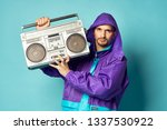 a man with a magnetaphone... | Shutterstock . vector #1337530922