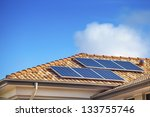 solar panels on suburban... | Shutterstock . vector #133755746