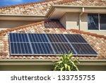 solar panels on suburban... | Shutterstock . vector #133755755