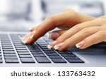 female hands typing on laptot ... | Shutterstock . vector #133763432