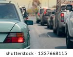 green car on the road in... | Shutterstock . vector #1337668115