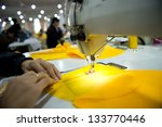Hand Sewing A Material On A...