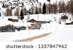 log cabins covered by snow in... | Shutterstock . vector #1337847962