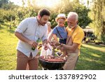happy family having barbecue... | Shutterstock . vector #1337892902