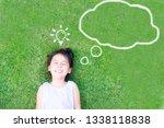 smart asian girl lay down on...   Shutterstock . vector #1338118838