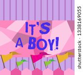 writing note showing it s a boy.... | Shutterstock . vector #1338169055
