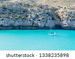 sailing boat on blue water... | Shutterstock . vector #1338235898