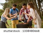 young people enjoying barbecue...   Shutterstock . vector #1338480668
