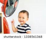 asian baby toddler boy put his...   Shutterstock . vector #1338561368