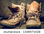 leather boots or moccasins | Shutterstock . vector #1338571028
