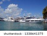 two luxury white motor yachts... | Shutterstock . vector #1338641375