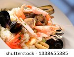 rice with seafood on a plate in ... | Shutterstock . vector #1338655385