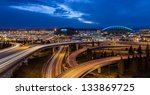 Seattle panorama of freeways under a deep blue evening sky and twinkling city lights at twilight