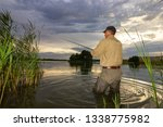 angler catching the fish during ... | Shutterstock . vector #1338775982