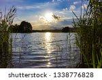 sun setting over lake  | Shutterstock . vector #1338776828