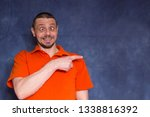 the cheerful man pretends to be ... | Shutterstock . vector #1338816392