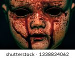 creepy bloody doll in the dark  | Shutterstock . vector #1338834062