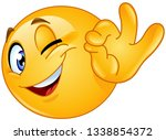 winking emoticon showing ok sign | Shutterstock .eps vector #1338854372