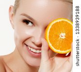 skin care . smiling girl with... | Shutterstock . vector #1338939188