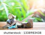 pile money coins saving set... | Shutterstock . vector #1338983438