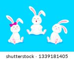 Stock vector white rabbits sitting with smiley face cute cartoon character design happy easter day vector 1339181405