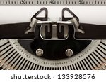 Close-up of typewriter with blank sheet of paper. Space for copy. - stock photo