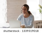 Small photo of Beautiful smiling woman working in headphones at office. Call center introduction. Happy employee at workplace. People at work at home. Video job interview, language course, class concept