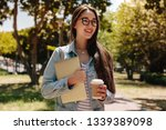 close up of a cheerful girl... | Shutterstock . vector #1339389098