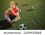 happy young player sit on lawn... | Shutterstock . vector #1339435868